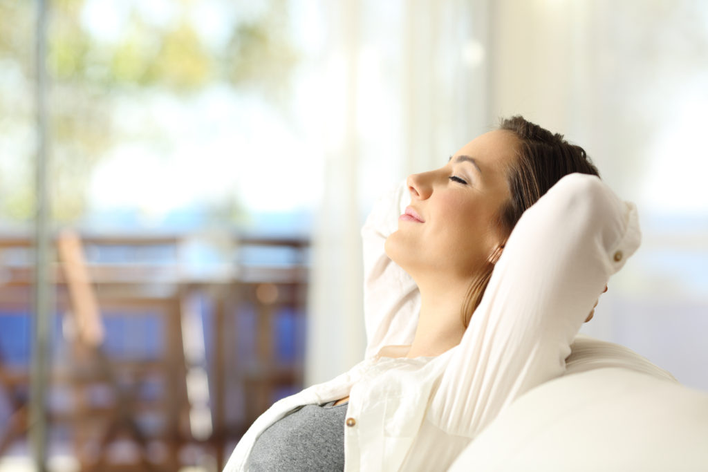 woman feeling stress-free and relaxed